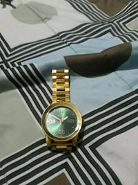 round gold-colored analog watch with link bracelet Moreno Valley, 92553