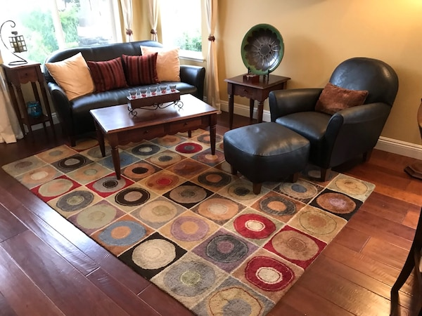 Miraculous Brown Leather Sofa Set Chair With Coffee Table Rug Pillows Nick Nacks Short Links Chair Design For Home Short Linksinfo