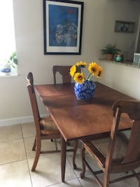 4 vintage farmhouse style wood chairs  Lake Park