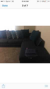 black fabric sectional sofa with pillows