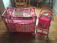 Baby's pink and multicolored travel cot