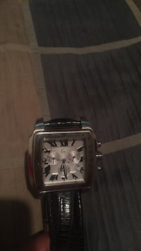 Square silver chronograph watch with black strap. Guess collection