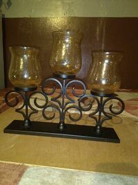 three glass candle holders with black steel stand