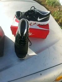 pair of black Nike cleats with box Rosemead, 91770