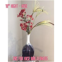 red and yellow faux flower arrangement with black and white vase Laval, H7G