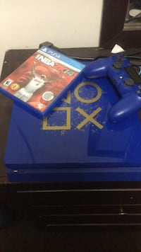 Blue sony ps4 console with controller and game cases Radcliff, 40160