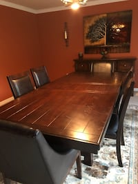Brown wooden dining table set Nokesville, 20181