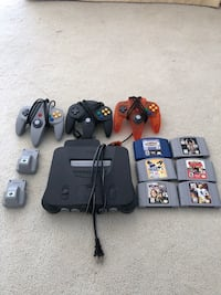 Black nintendo 64 console with controllers and game cartridges Washington