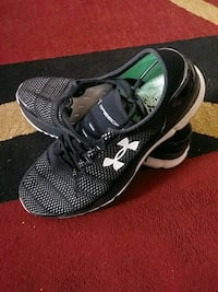 pair of black-and-white Nike running shoes