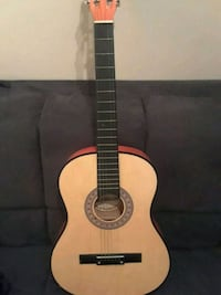 brown and black classical guitar Belleview