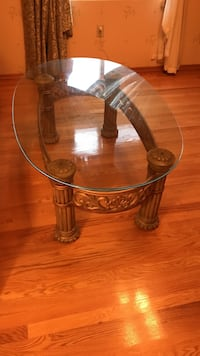 Brown wooden frame glass top coffee table New York, 10308