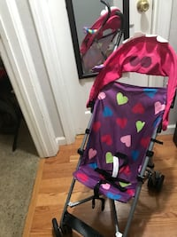 purple and pink heart print lightweight stroller with canopy