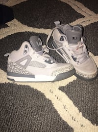pair of gray-and-white Nike running shoes West Des Moines, 50266