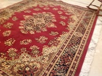 red, white, and black floral area rug 3119 km