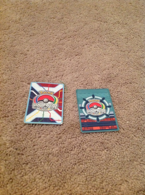 Two world championships pokemon cards signed