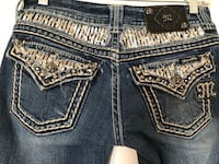 Miss Me jeans. Size 27, inseam 31. Missing 2 emblems on outside tag, as shown. The bling color is silver.  Cape Girardeau, 63701