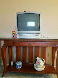 gray CRT TV with brown wooden TV hutch 2049 mi