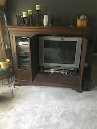 black CRT TV with brown wooden TV hutch Lorton, 22079