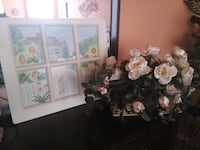 Framed picture and flowers in basket Allen