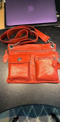 Roots red leather crossbody bag Richmond, V7C 3K8