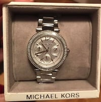 Firm Brand New Authentic Michael Kors Silver Watch, Paid $400 comes with the box and still has tags on it. In smoke free and pet free home pickup Kennedy and Sandalwood Brampton