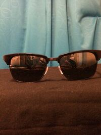 black clubmaster-style sunglasses