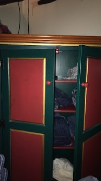 Red and green armoire. Heavy duty with a lot of space.  Heath, 43056