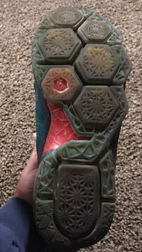unpaired green, red and blue basketball shoe