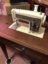 Sewing machine in a cabinet and Chair