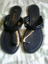 pair of black leather sandals London, N6E 2B2