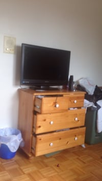 flat screen television with brown wooden TV stand Edmonton, T5C 3L3