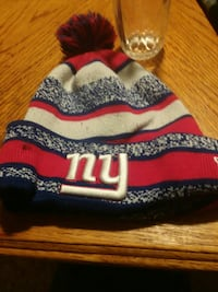 white, red, and blue New York ball knit cap