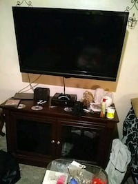 flat screen TV and black wooden TV stand 159 mi