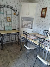 Black metal framed glass top table with chairs and buffet