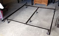 Heavy duty metal bed frame with center bar for added support.