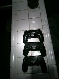 black and white Sony PS4 with DualShock 4 2276 mi