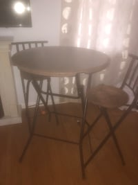 round white wooden table with gray metal base Bethlehem, 18017