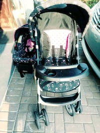 baby's black and pink floral travel system Orlando, 32824