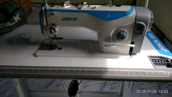 white and blue Brother sewing machine