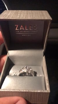 Sterling silver engagement ring size 9 with three 14 carat diamonds