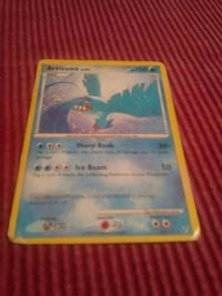 blue and white Pokemon trading card Umatilla, 32784