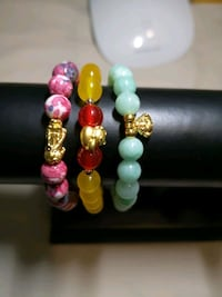 Real 24karat Lucky charm bracelets with natural beads Surrey, V3V 3N8