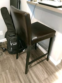brown wooden framed black leather padded chair null
