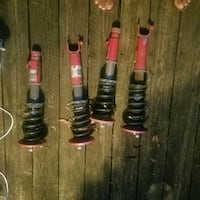 four red and black shock absorbers 48 km