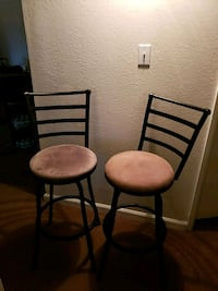 two black metal framed brown padded chairs 2053 mi