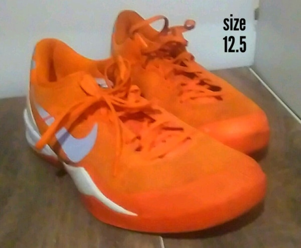 Orange Nikes size 12.5