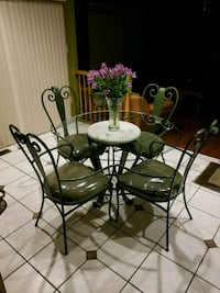 round glass top table with four chairs Rockville, 20850