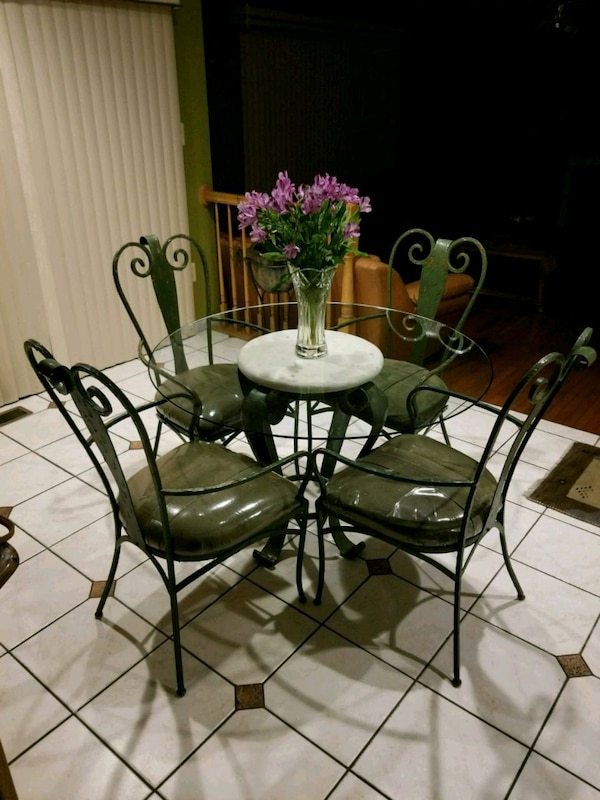 round glass top table with four chairs