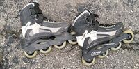 pair of black-and-white inline skate Ajax, L1S 7C8