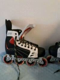 unpaired white and black inline skate Montréal, H1G 4G9